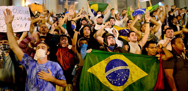 Brazilian people protesting against corruption and poor public