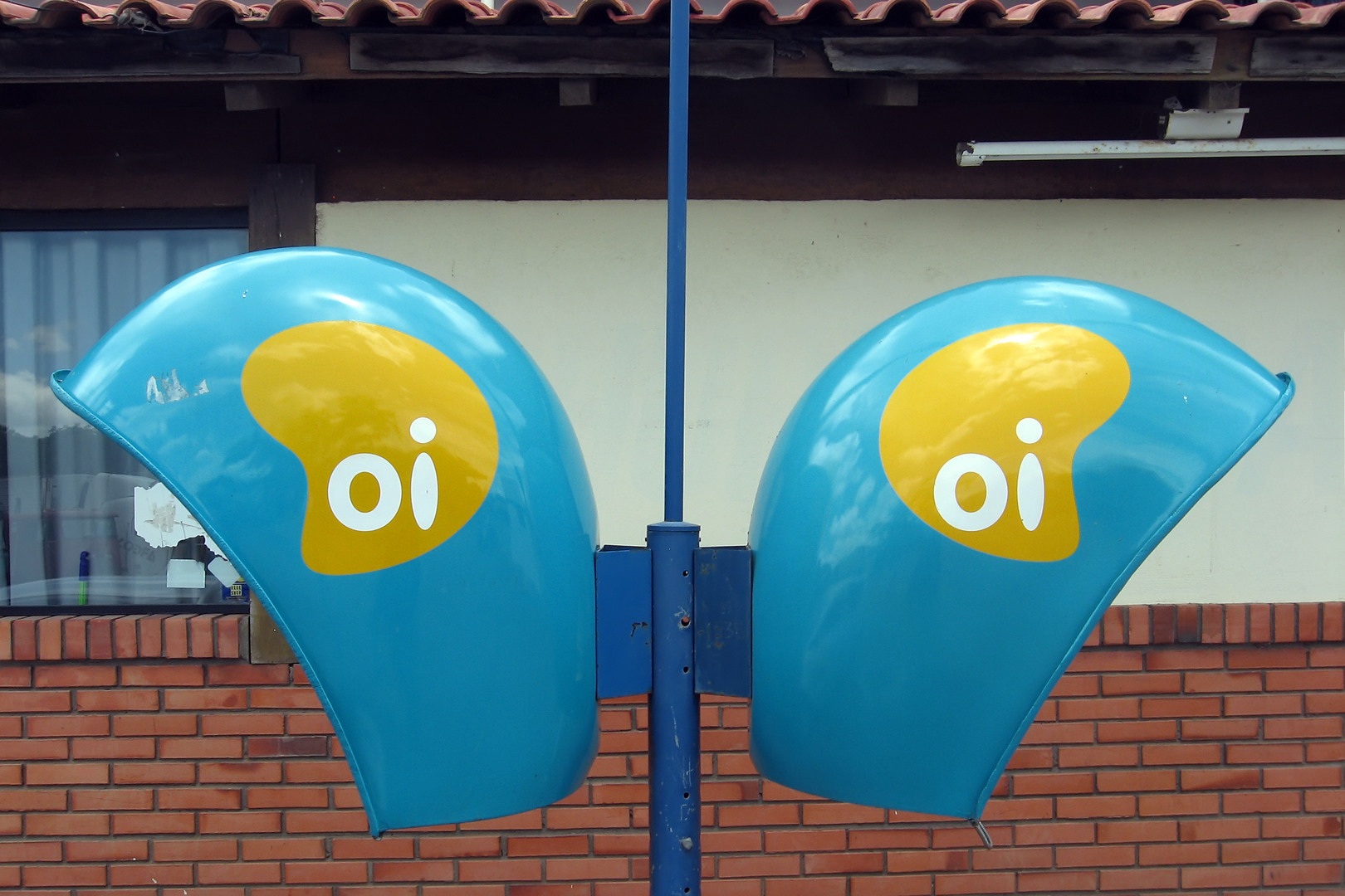Oi branding, in two phone booths in Brazil