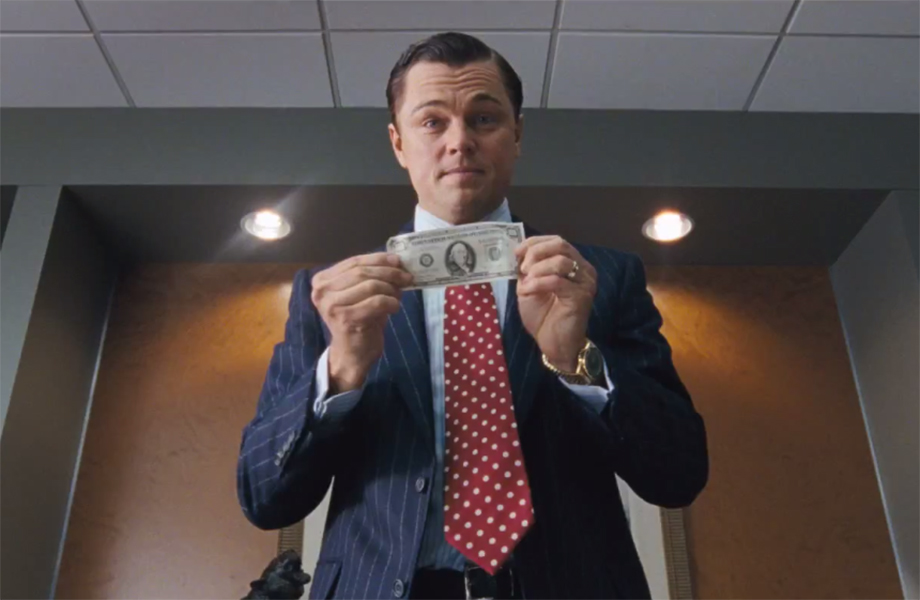 Leonardo Di Caprio holding a money bill, in Wolf of Wall Street