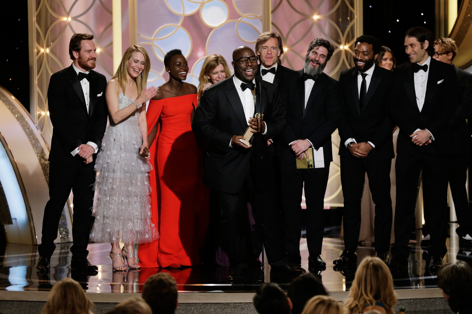 The 12 years a slave crew on stage, receiving the oscar for best picture in 2014
