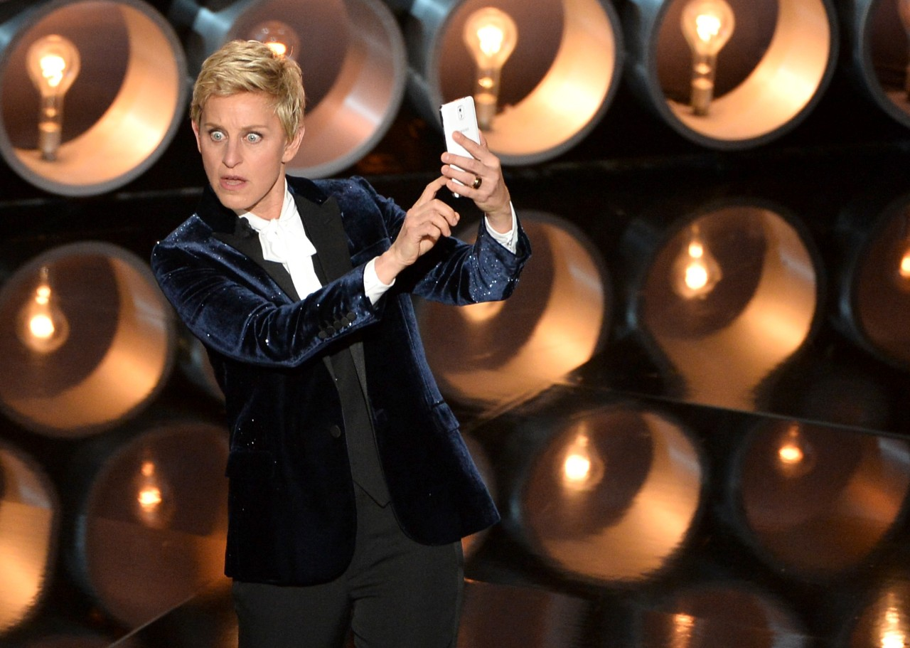 Ellen DeGeneres taking a photo with a Samsung mobile phone