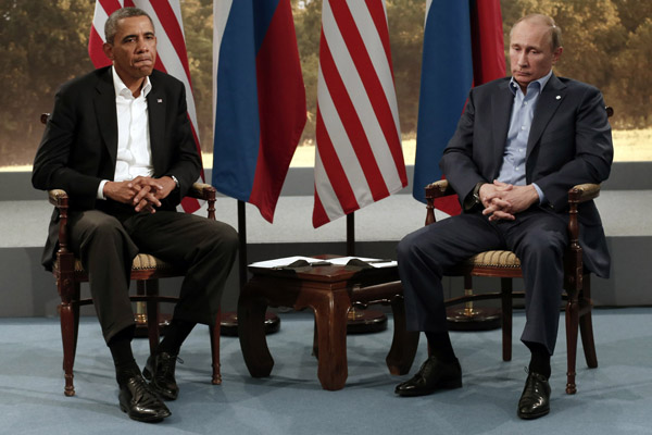 President Barack Obama is building pressure on Russia's Vladimir Putin to back down on Ukraine, where the war has lately taken a surprising turn against the Russian-backed separatists.