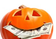 Halloween pumpkin with US dollar bills