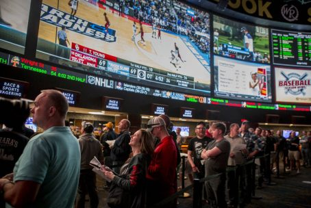 People betting on sports in Vegas