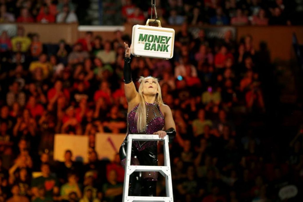 A WWE female superstar reaching out to a money case during an event