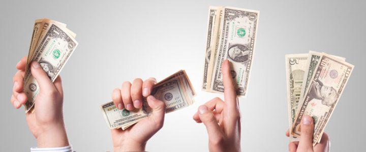 Hands stretching money bills