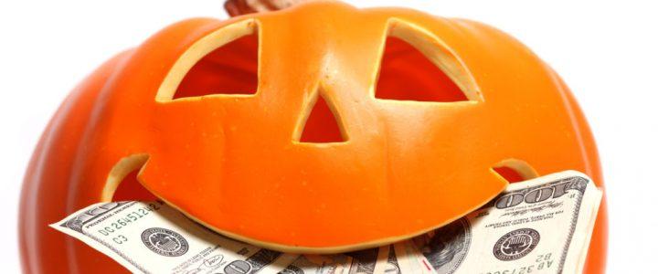 Halloween pumpkin with US dollar bills
