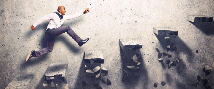 Man climbing stairs to success