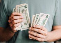 A man handling money bills